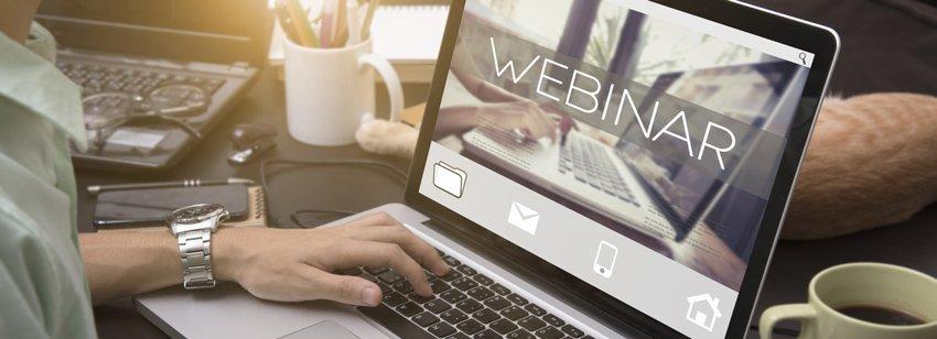Man views webinar on laptop