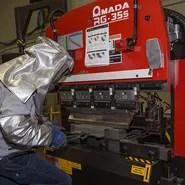 titanium part being formed on brake press