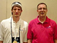 Mackenzie (left) and his former Network Systems instructor, Mark Robinson (right), pose together.