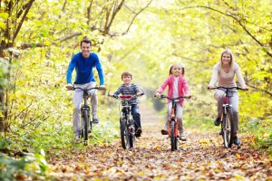 healthy family on bicycles