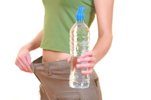 woman dieter with a bottle of water