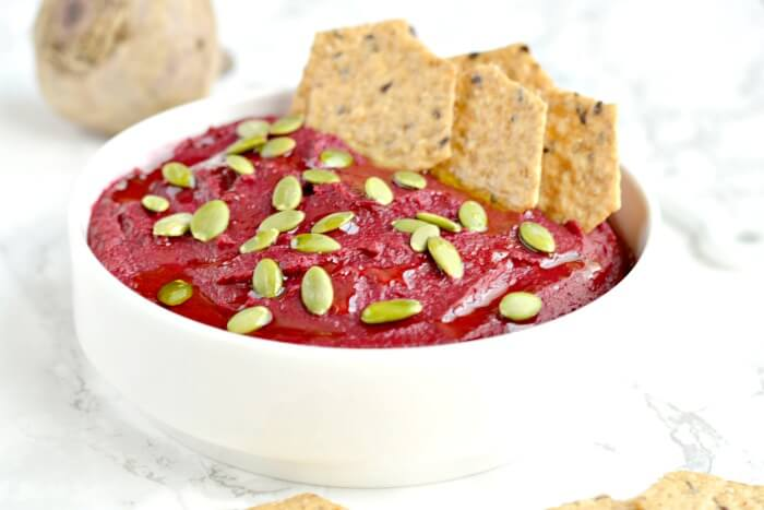 Creamy White Bean Beet Hummus made with 6 healthy ingredients and a pumpkin surprise. A hearty dip that's remarkably delicious, tastes nothing like beets and sure to be the star of the party! Vegan + Gluten Free + Low Calorie