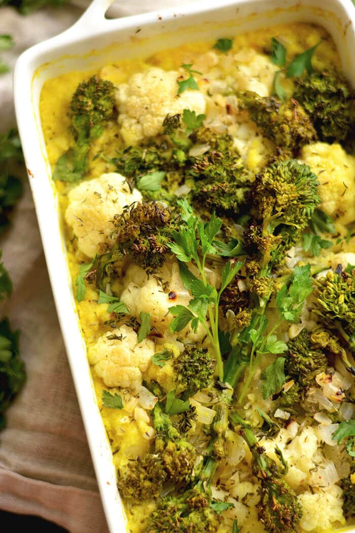 Turmeric Cauliflower Broccoli Gratin casserole made with a rich white wine sauce & sprinkled with parmesan cheese. A low carb side perfect for dinner or the holidays!