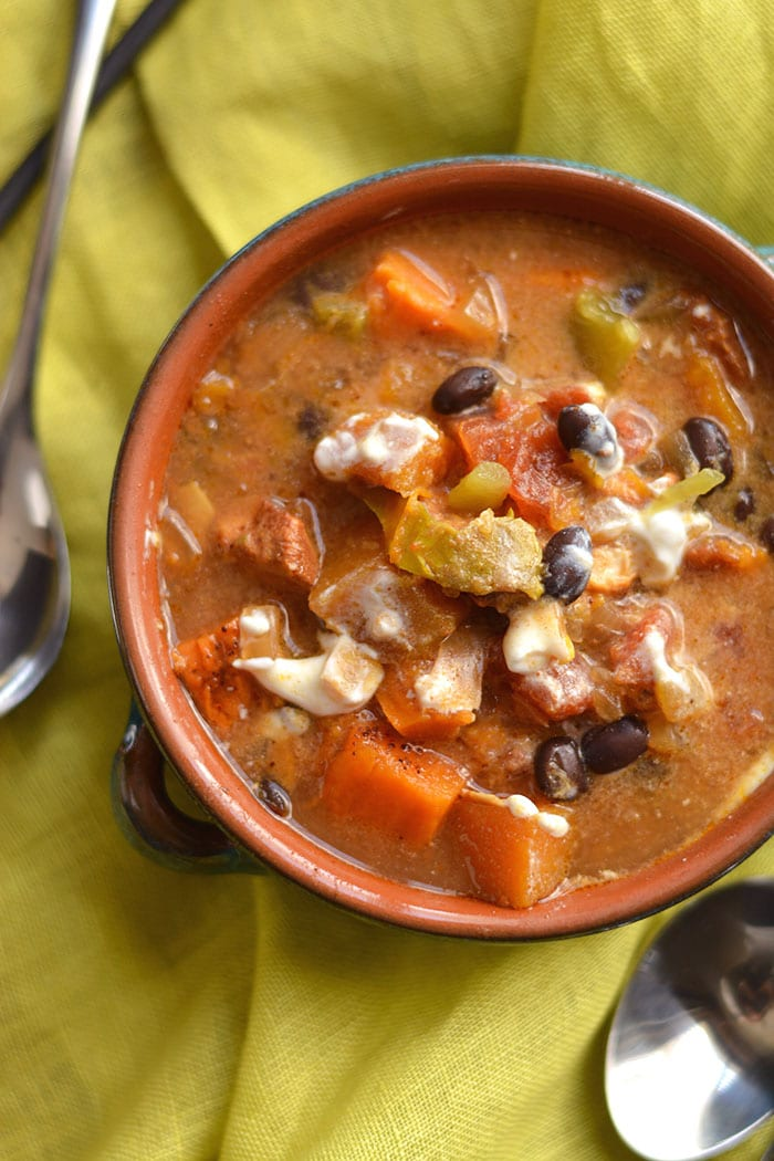 Crockpot Butternut Chicken Chili with Black Beans! This protein packed chili made easy in the crockpot fills your kitchen with wonderful flavors & your stomach with nourishing, healthy ingredients! Gluten Free + Low Calorie