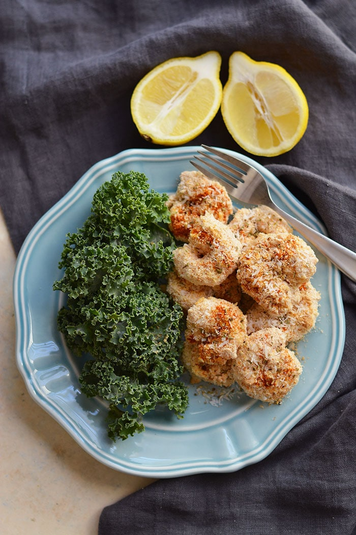 """One Pan Baked Coconut Shrimp! Crispy, crunchy, spicy shrimp baked to perfection on a sheet pan. A """"breaded"""" shrimp recipe that's healthy and grain free. Gluten Free + Low Calorie + Paleo"""