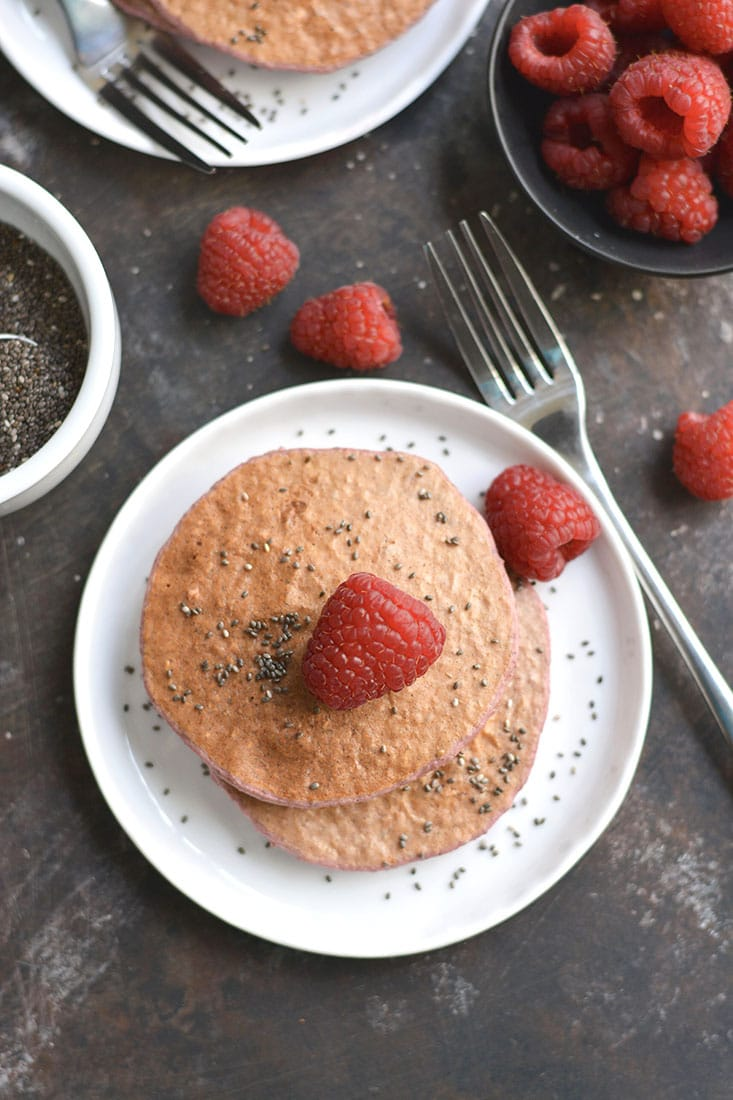 Raspberry Chia Protein Pancakes are too good to be true! Protein packed, made with simple wholesome ingredients, lower in sugar, and so tasty! Just blend, cook, and eat! Gluten Free + Low Calorie