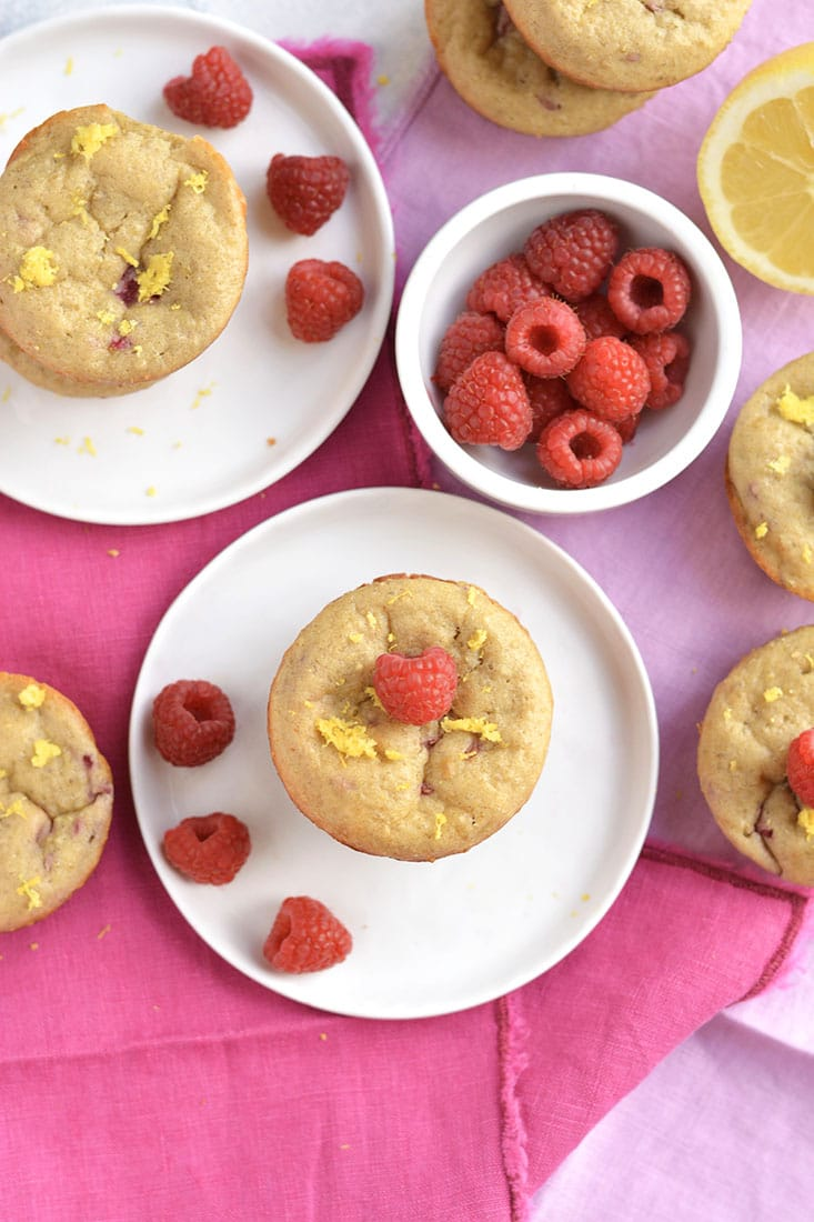Moist & fluffy Raspberry Lemon Quinoa Muffins! These protein-packed muffins have summery flavors, are lightly sweet & packed with nourishment. Great for breakfast, brunch, or anytime! Gluten Free + Low Calorie