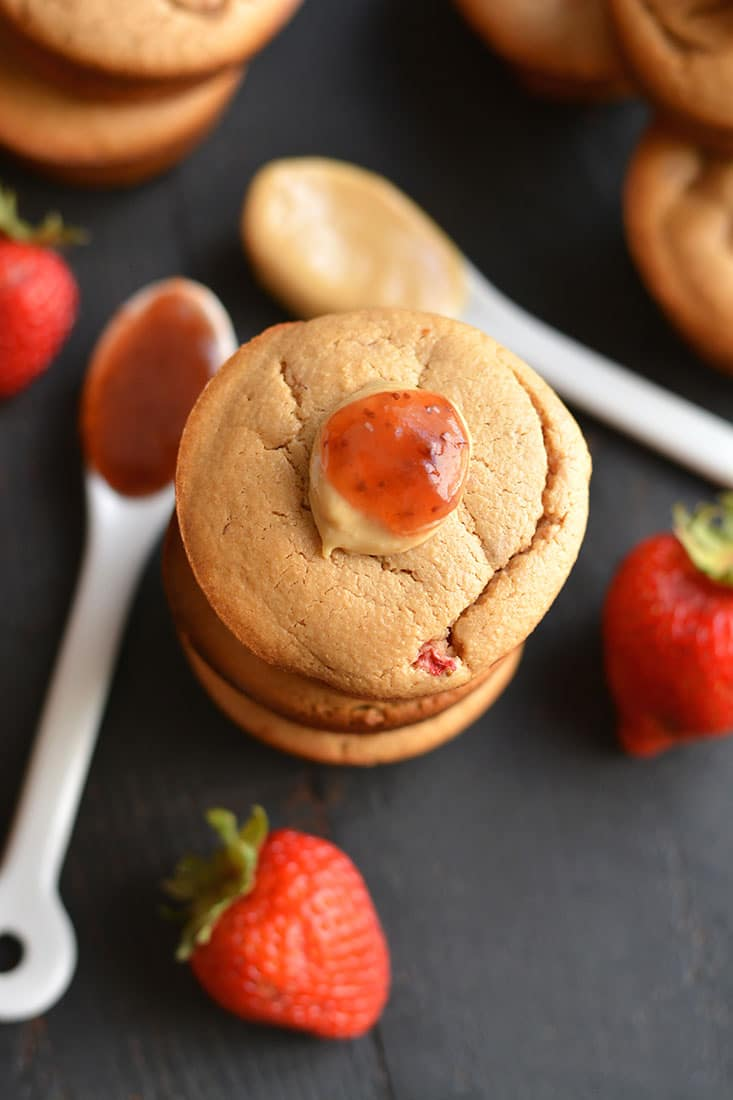 Healthy Peanut Butter & Jelly Muffins! These almond flour PB&J muffins are creamy, protein-packed & lightly sweetened with fresh strawberries. Take one with youfor a healthy snack on the go! Gluten Free + Low Calorie