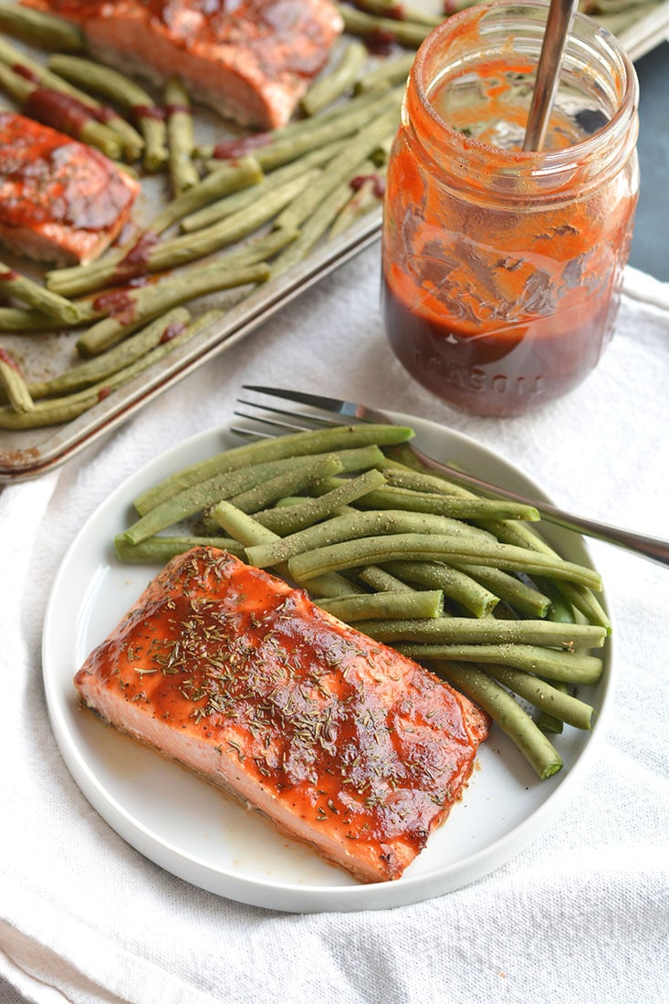 Low Sugar BBQ Salmon made on a sheet pan in less than 20 minutes. Low sugar BBQ sauce, thyme & green beans compliment the meal perfect. A hearty, yet healthy meal with simple good for you ingredients. Gluten Free + Low Calorie