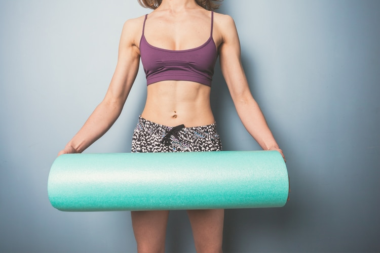 Use a foam roller at home to reduce muscle soreness and tension.