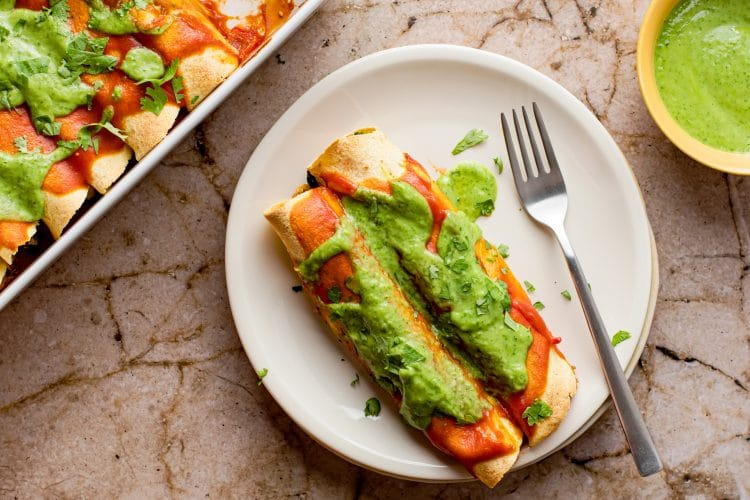 Enchiladas with black beans and tofu with a creamy coriander and lime sauce