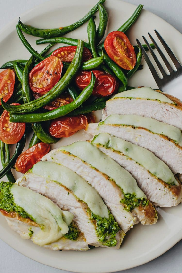 Tasty pesto chicken and warm roasted vegetables will satisfy your cravings and fill your tummy!