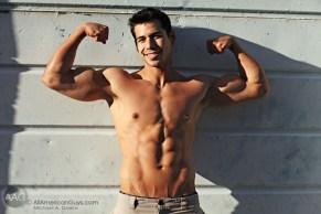 Jon Hayes flexing biceps