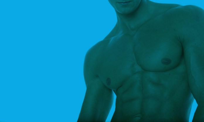 A close up of a man's pecs and abs