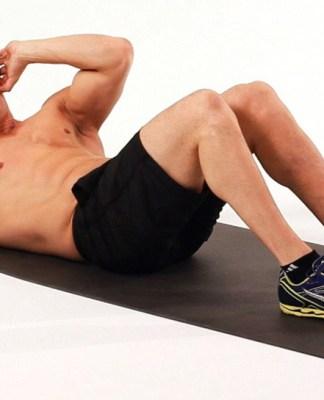 A man doing crunches on a mat