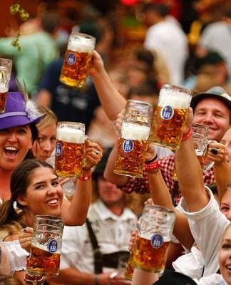 People raising beer glasses at Octoberfest