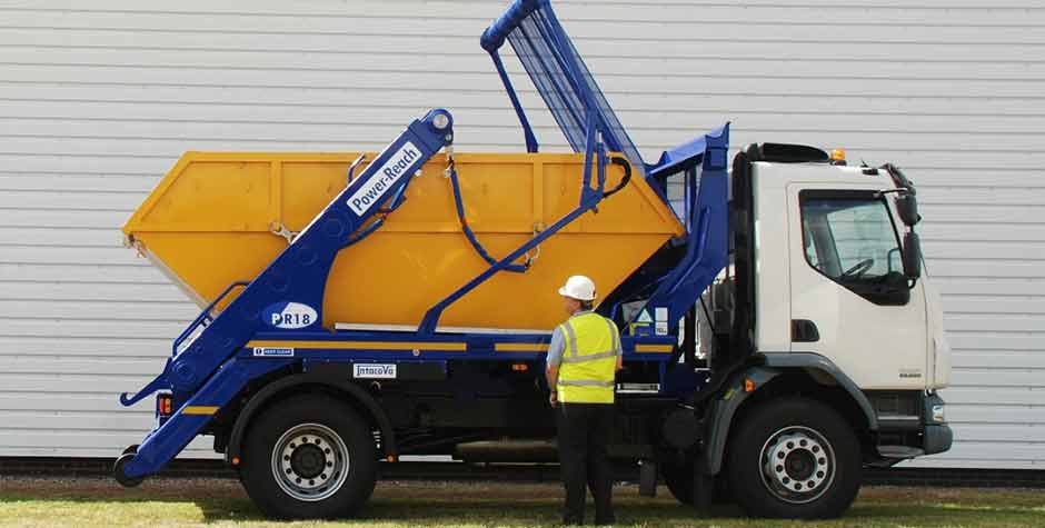 Nuneaton-Unloading-skips-off-lorry
