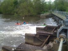 People playing down stream of the weir