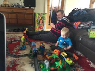 Granddad and MiniBoyGeek playing trains