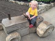MiniBoyGeek on a tractor