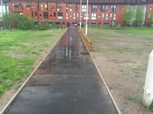 View of the path from the tram station towards the lock and Chips building