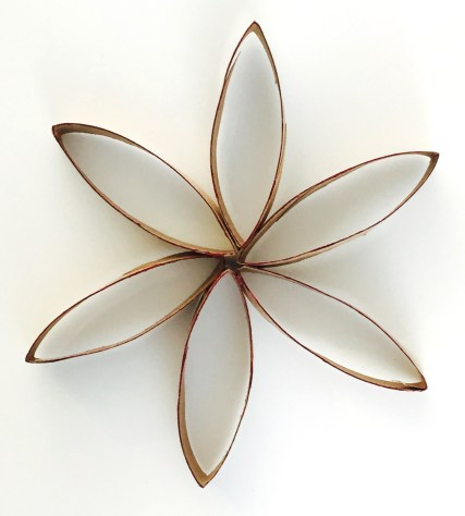 A flower made from slices of toilet paper tubes.
