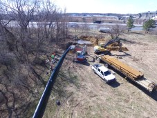 Receiving Pit- the black sewer pipe is connected to the end of the steel rod from the Drill Rig and is pulled back under Rt. 50