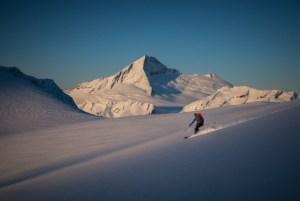 Backcountry ski touring on the Dart Glacier, SW ridge of Mt Aspring behind