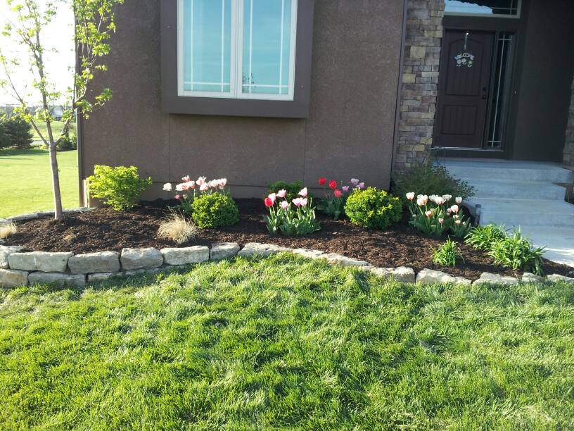 April showers bring may flowers and lawn care sk lawn for The garden design sk
