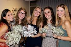 Sisters posing with centerpieces!