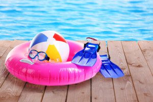 35556680 - bright beach accessories on pool background