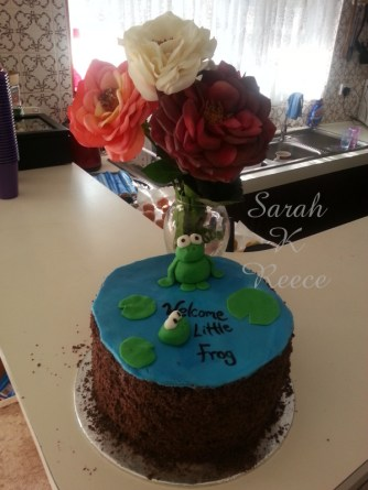 Gorgeous frog cake and a rose for each Grandma who can't be present in person