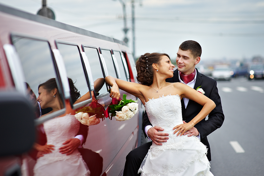 Wedding and Corporate event, limo transportation service, San Francisco CA USA - Happy bride and groom near wedding limo in San Francisco CA, Napa Valley CA
