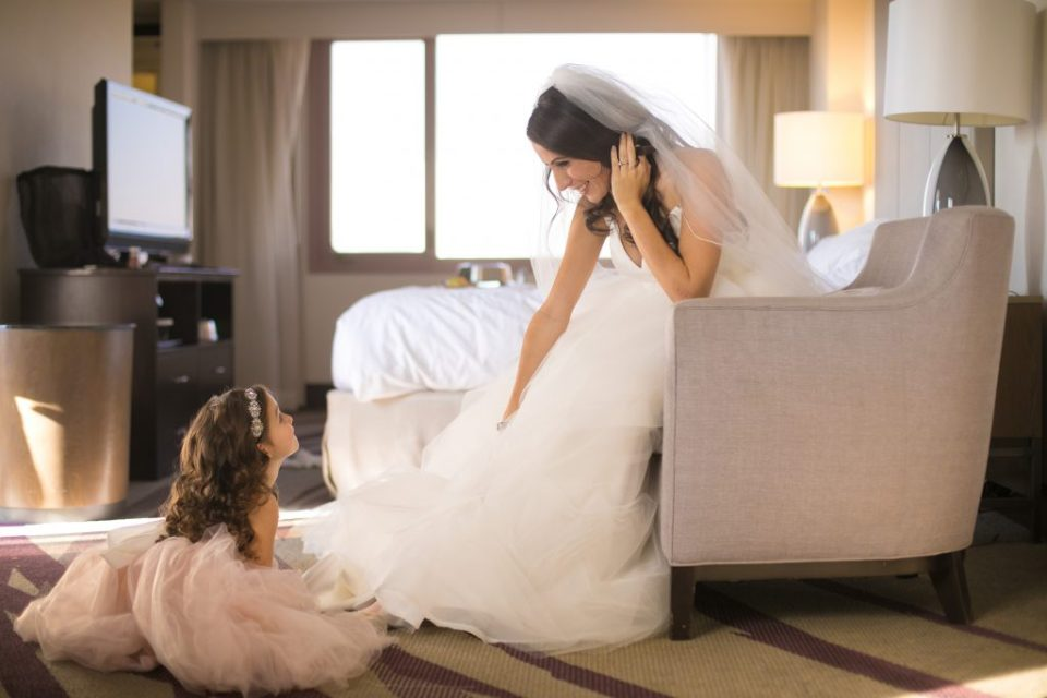 bride getting ready in hotel with daughter