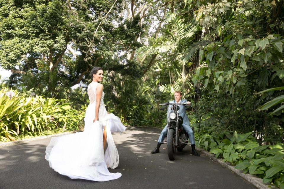 newlyweds exit their green hawaii wedding
