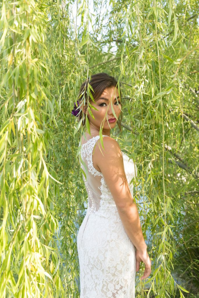 bride under tree at milagro wedding venue in Ramona, California