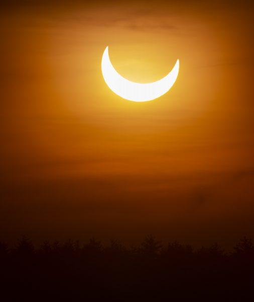 Partial solar eclipse above Auburn, New Hampshire