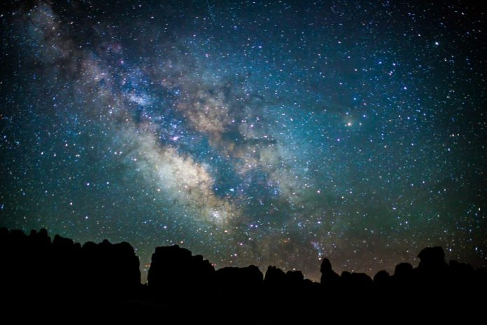 milky way above the silhouette of rock pinnacles