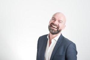 bald man laughing healthy teeth