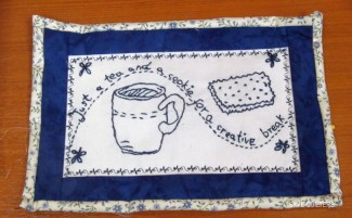 Blue and white quilted mug rug