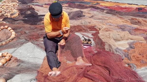 Fisherman in Peniche Repairing Nets
