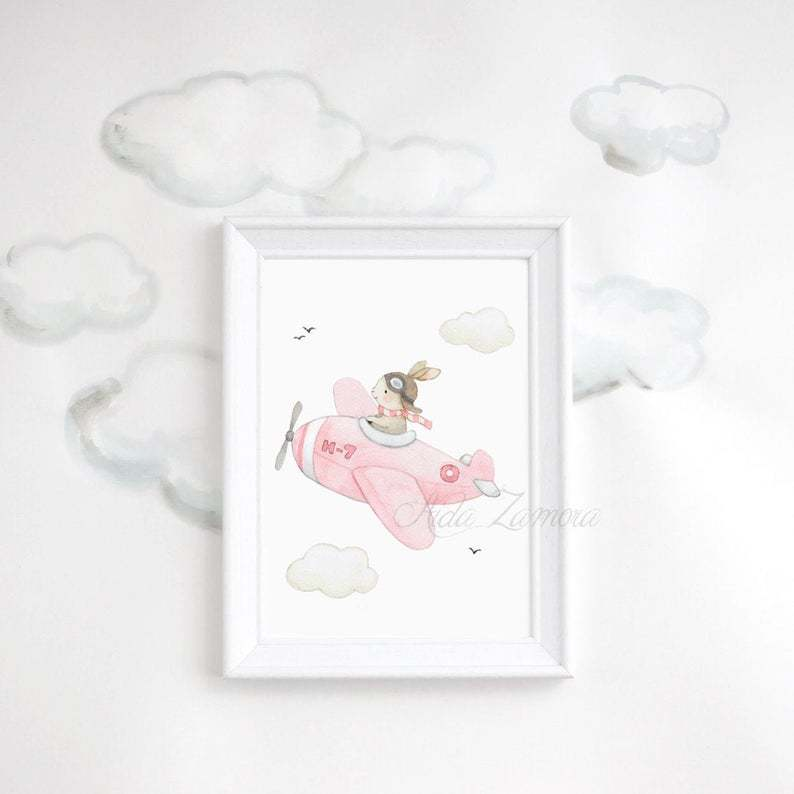 Watercolour painting of a pink airplane with a bunny rabbit pilot in a white wooden frame