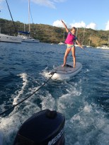 Surfing behind the dinghy