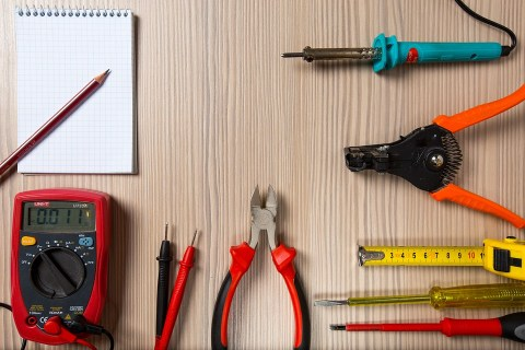 """An image depicting a soldering iron, electrical test tools, screwdrivers, and other hand tools. The image was used on a smart home link roundup under the heading, """"For tinkerers."""""""