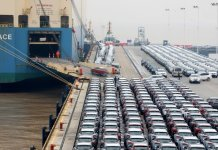 Geely cars for export enter a cargo vessel at Ningbo Zhoushan port in Zhejiang province