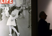 """The sailor pictured kissing a woman in Times Square as people celebrated the end of World War II has died at age 95, his daughter told the Providence Journal. George Mendonsa had a seizure Sunday after falling at an assisted living facility in Middleton, Rhode Island, his daughter Sharon Molleur said. In the famous image, one of four taken by Alfred Eisenstadt for Life magazine, Mendonsa is seen ecstatically bending over and kissing a woman in a white nurse's uniform. The picture was published by Life as """"V-J Day in Times Square."""" Mendonsa, who served in the Pacific during World War II, was on home leave when the picture was taken. He had long claimed to be the sailor in the picture, but it wasn't confirmed until recently with the use of facial recognition technology. Greta Zimmer Friedman, the woman in the picture, died in 2016 at age 92. Eisenstadt did not get the names of the kissing strangers. He later described watching the sailor running along the street, and grabbing any girl in sight. """"I was running ahead of him with my Leica looking back over my shoulder but none of the pictures that were possible pleased me,"""" he wrote in """"Eisenstadt on Eisenstadt."""" """"Then suddenly, in a flash, I saw something white being grabbed. I turned around and clicked the moment the sailor kissed the nurse. If she had been dressed in a dark dress I would never have taken the picture."""" Mendonsa, who served in the Pacific during World War II, was on home leave when the picture was taken."""
