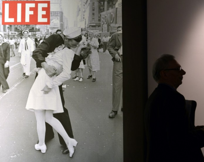The sailor pictured kissing a woman in Times Square as people celebrated the end of World War II has died at age 95, his daughter told the Providence Journal. George Mendonsa had a seizure Sunday after falling at an assisted living facility in Middleton, Rhode Island, his daughter Sharon Molleur said. In the famous image, one of four taken by Alfred Eisenstadt for Life magazine, Mendonsa is seen ecstatically bending over and kissing a woman in a white nurse's uniform. The picture was published by Life as