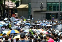 Thousands converge on Hong Kong police HQ in anti-govt demo