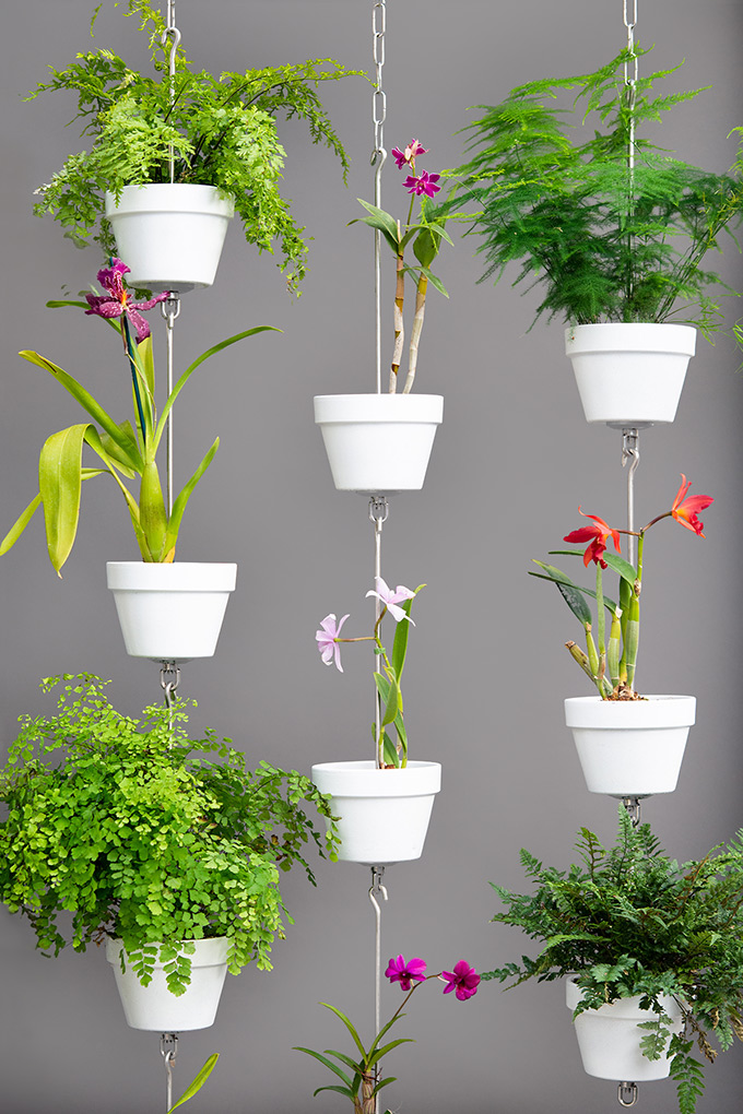 SkyPots vertical garden arrangement with orchids, ferns and painted clay pots.
