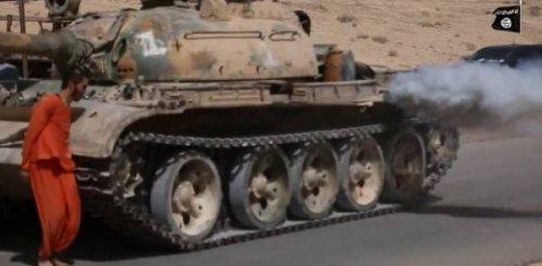 بالصور : داعش يبتكر طريقة جديدة للاعدام